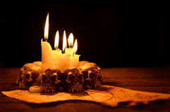 Evil candle light Stock Images