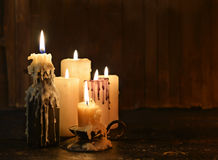 Evil Candles On Wooden Background Royalty Free Stock Photography