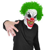 Evil Clown. A clown with scary teeth,green hair and funny gesture royalty free stock images
