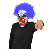 Evil Clown. A clown with scary teeth,blue hair and funny gesture stock photos