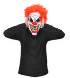 Evil Clown. A clown with scary teeth,red hair covers his ears royalty free stock image