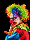 Evil clown on black background. Portrait of crazy woman. Royalty Free Stock Images