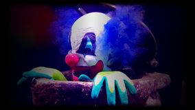 Evil Clown on Black Background. Evil Clown Under Water on Black Background - 4K Video stock video footage