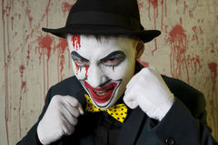 Evil clown boxer wearing a bowler hat on wall Stock Photography