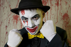Evil clown boxer wearing a bowler hat on wall Stock Image