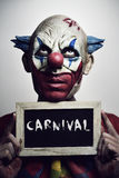 Evil clown and text carnival Royalty Free Stock Images