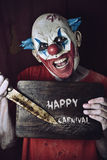 Evil clown and text happy carnival Royalty Free Stock Image