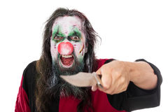 Evil clown threatening the beholder with a knife, isolated on wh. Ite, concept scary halloween Stock Photography
