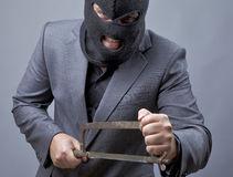 Evil criminal wearing military mask Stock Images