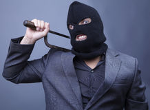 Evil criminal wearing military mask Stock Photo