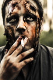 Evil dead zombie smoking cigarette outside Stock Photos