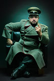 The evil dictator. Sitting in a chair Royalty Free Stock Photos
