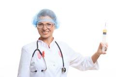 Evil doctor with big syringe Royalty Free Stock Image