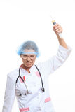 Evil doctor with big syringe Stock Photography