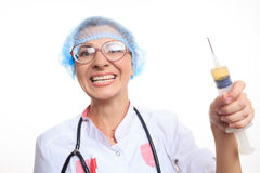 Evil doctor with big syringe Royalty Free Stock Image