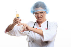 Evil doctor with big syringe. On a white background Royalty Free Stock Images