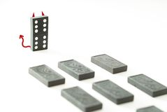 Evil domino king Stock Photos