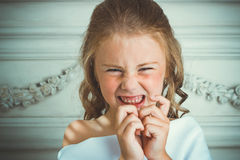 Evil emotion and smile, little beautiful angel Stock Photo