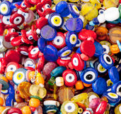 Evil eye. Glass evil eye in different colors at Turkish bazaar Stock Photos