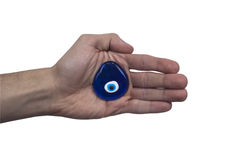 Evil Eye Amulet. Evil Eye or Nazar amulet on the palm using by good luck in turkish culture Stock Photo
