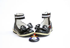 Evil eye amulet and Black Shine Leather Girl Shoes . Bow Tie Royalty Free Stock Photography