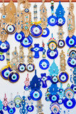 Evil eye amulets. Turkish blue evil eye amulets, jewelry, souvenirs, pendants made of glass which brings protection and gives luck to everyone Royalty Free Stock Image