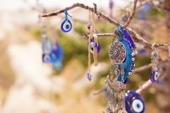 Evil eye bad on tree Royalty Free Stock Photo