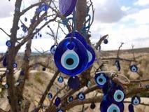 The evil eye blue turkey amulet. Turkey shots pics Royalty Free Stock Images