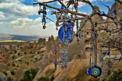 Evil eye charms hang from a bare tree in Cappadoci Royalty Free Stock Image