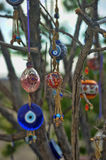Evil eye charms hang from a bare tree in Cappadoci Stock Photos