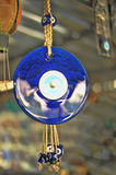 Evil eye charms hang from a bare tree in Cappadoci Royalty Free Stock Photo