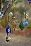Evil eye charms hang from a bare tree in Cappadoci Stock Images