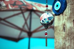 Evil eye charms hang from a bare tree in Cappadocia, Turkey Royalty Free Stock Photo