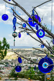 Evil eye charms hang from a bare tree in Cappadocia Stock Image