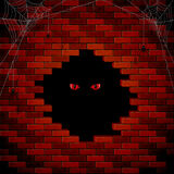 Evil eye in the hole of the brick wall Royalty Free Stock Photos