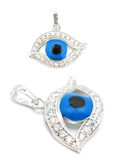 Evil eye pendant. Two perspectives of an evil eye pendant isolated on white Stock Image