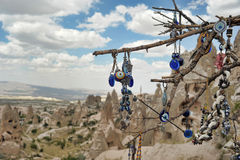 Evil eye in tree behind Love valley in Goreme national park. Cappadocia Royalty Free Stock Photos