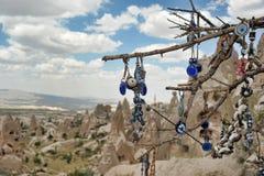 Evil eye in tree behind Love valley in Goreme national park. Cappadocia Royalty Free Stock Photos