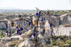 Evil eye in tree behind Love valley in Goreme national park. Cappadocia Royalty Free Stock Photo