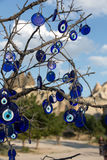 Evil eye in tree behind Uchisar Castle Royalty Free Stock Image
