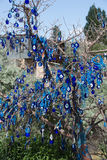 Evil eye in tree behind Uchisar Castle in Cappadocia Royalty Free Stock Photography
