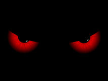Evil eyes. Red evil eyes on a black background Royalty Free Stock Photography