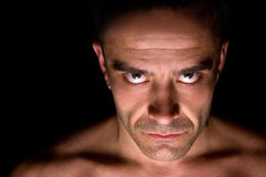 Evil eyes. Portrait of a male with piercing eyes Stock Images