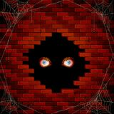 Evil eyes in the hole of the brick wall and spiders. Halloween background with evil eyes in the hole of the brick wall and black spiders on the spiderweb vector illustration