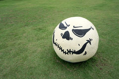 Evil face painted on round stone Royalty Free Stock Image