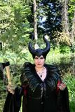 Evil fairy tale, maleficent, malevolent queen with horns and crow feather gown Royalty Free Stock Photo