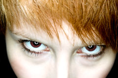 Evil female vampire eyes watching Stock Image