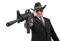 Evil gangster and his gun, isolated on white Royalty Free Stock Photography