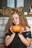 Evil girl with pumpkin Royalty Free Stock Photography
