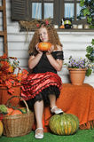 Evil girl with pumpkin Stock Images